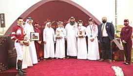 Taleb Meteb al-Saaq (fifth from left) with the winners of the Al Zubara Trophy after Aaley Al Magam