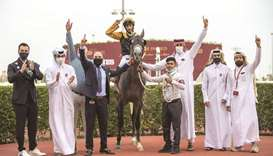 Trainer Wasim al-Sahn (fourth from left) and connections celebrate in the winner's enclosure after G